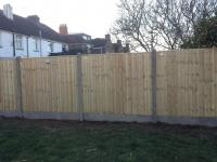 close board panels with concrete posts & gravel boards<br>