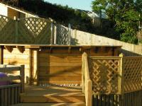 Decking, lattice trellis, close board, elite panels all around a swimming pool<br>