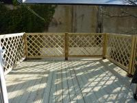 decking on a roof with lattice trellis and hand rail<br>