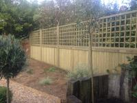 Tongue and groove panels with trellis and slotted wooden posts
